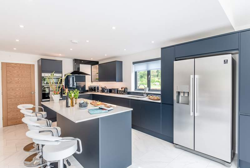 This modern and spacious kitchen is heaven for those that love to cook and has a large American fridge/freezer.