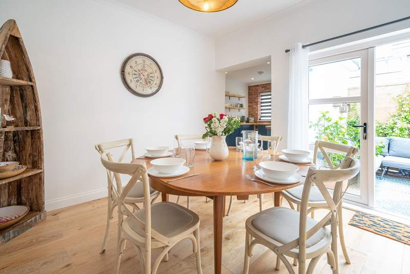 A lovely setting to gather round and enjoy supper in the beautifully decorated dining-room.