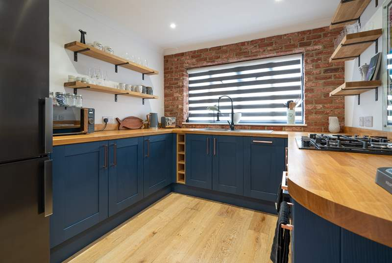 Cook up a family favourite in this modern stylish open plan kitchen.
