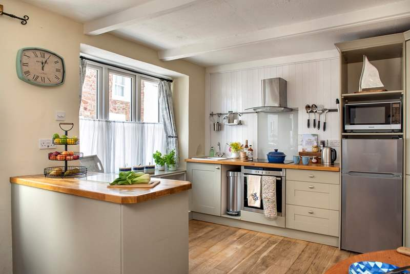 The cottage kitchen is quite charming.