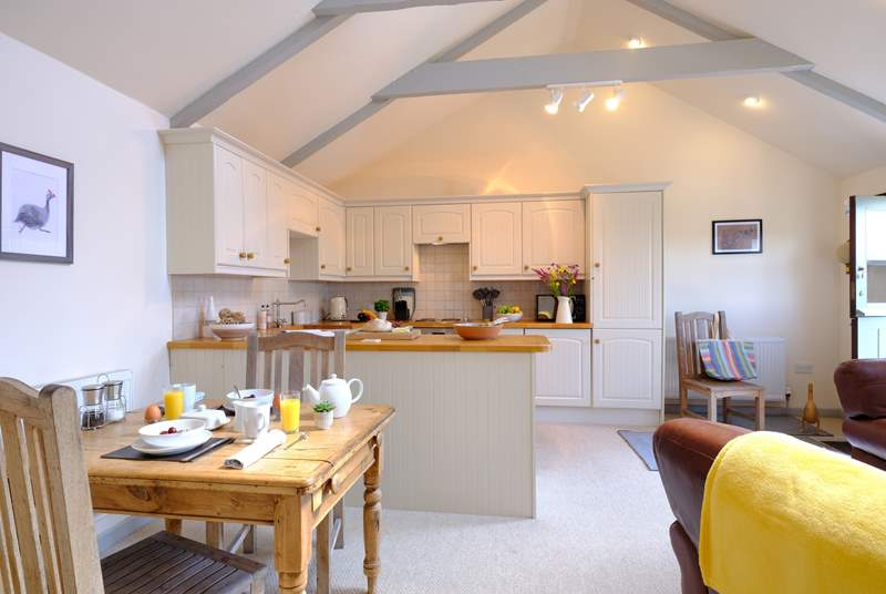 Little Downderry Barn has an open plan living, dining and kitchen areas.