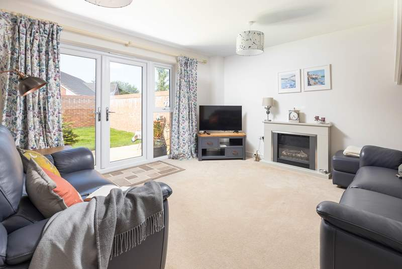 The spacious sitting-room with an electric fire for those cooler evenings.