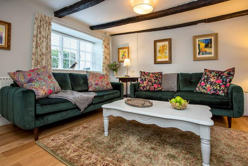 The cottage sitting-room invites you to unwind and relax.
