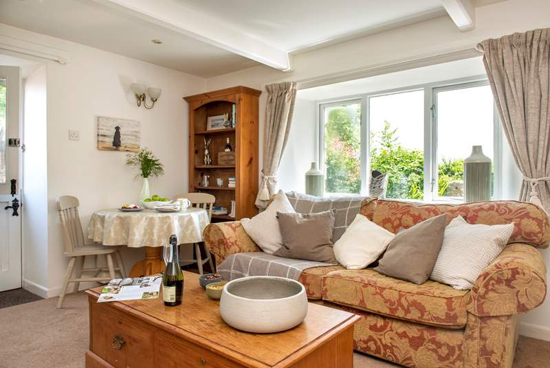 The open plan sitting and dining area will make you feel at home from the minute you step inside.