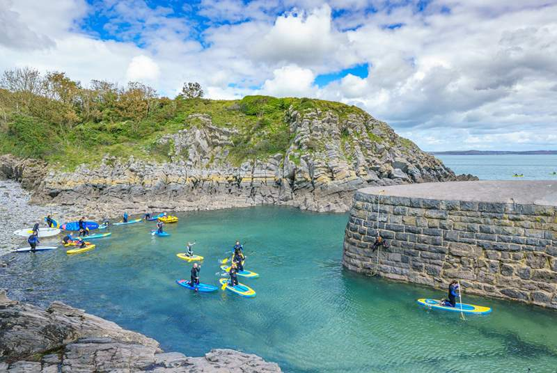 Make the sea a part of your holiday and try stand up paddle boarding at Stackpole Quay.