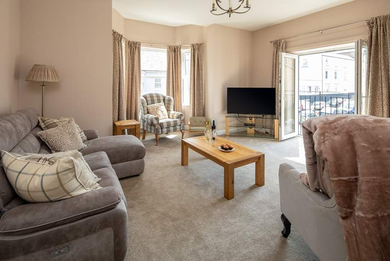 With patio doors opening onto the Juliet balcony, the first floor sitting-room is bright and airy.