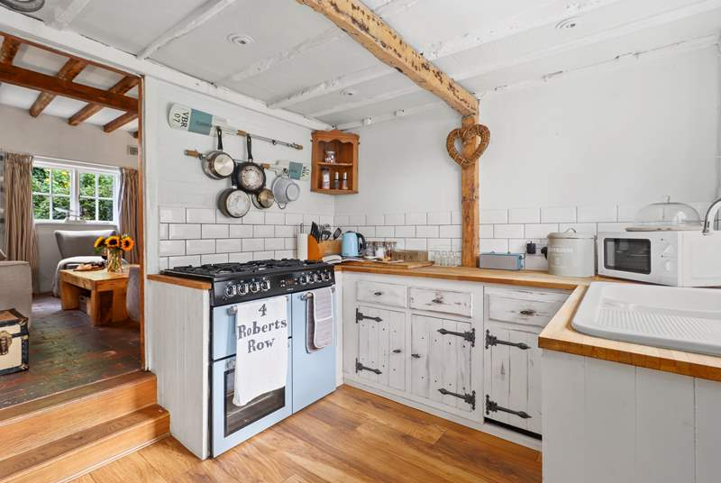 The country-style kitchen with range cooker has everything you need to  create that special meal.