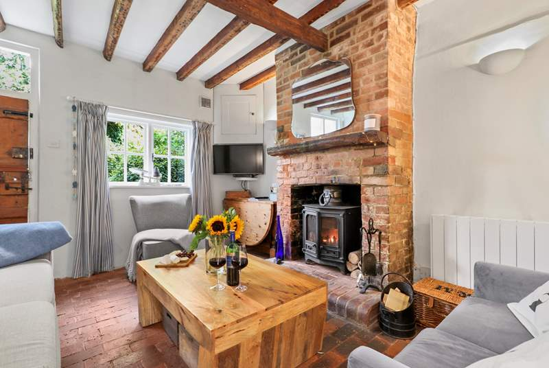 The cosy sitting/dining-room with an inviting wood-burner for those chilly afternoons and evenings.