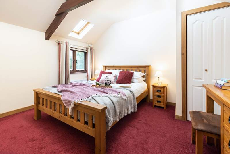 The bedroom has a king-size bed and built-in wardrobe.