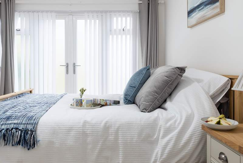 The calming bedroom has a king-size bed.