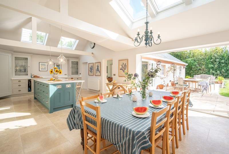 The luxurious kitchen/dining-room showcases plenty of light and space.