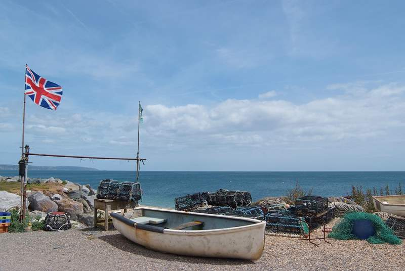 Boats and lobster pots on the beach at Beesands.