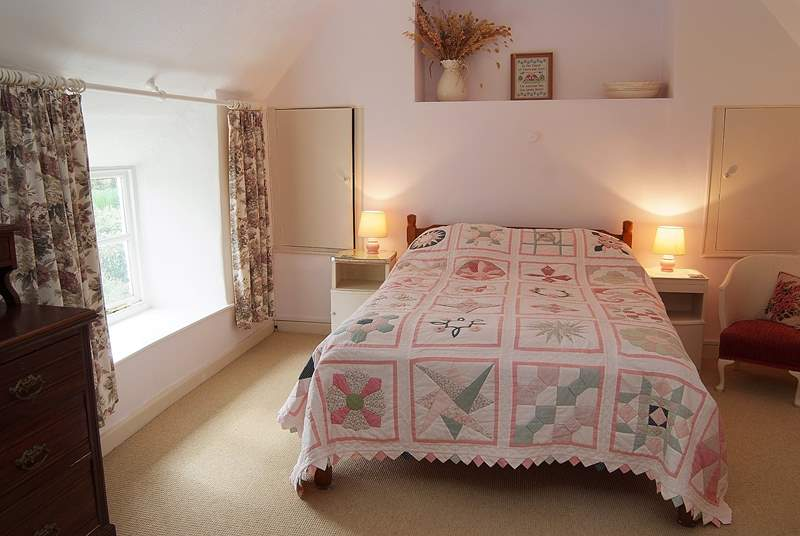 Bedroom 1 is a spacious double room overlooking the pretty cottage garden at the front.