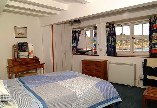 The ground floor double bedroom with an en suite shower cubicle and fabulous sea views.