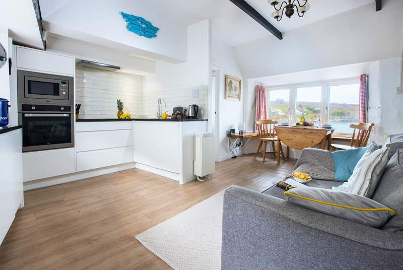 The light and surprisingly spacious open plan living-area with space to cook, eat and relax with the most amazing view.