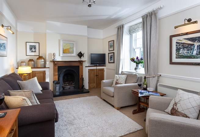 The Victorian cast-iron fireplace adds character to the cosy sitting-room as well as additional warmth on those cooler evenings.