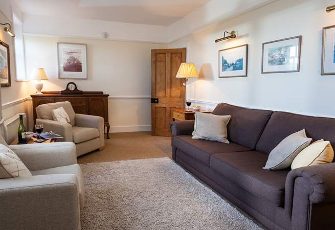 The sitting-room is lovely and cosy, enjoy a glass of wine and good company.
