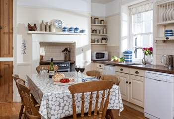 The kitchen, complete with farmhouse kitchen table, is extremely well-equipped.