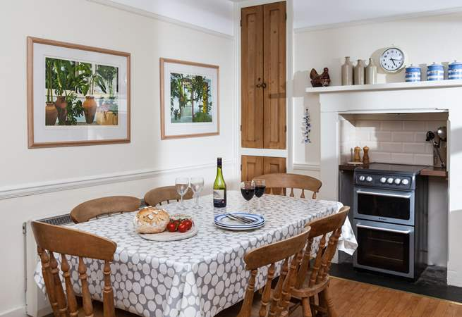 The kitchen is the heart of the cottage and leads to the sitting-room, dining-room and also the utility-room.