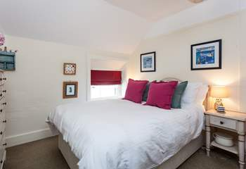 This cosy bedroom is tucked away at the back of the house, away from any stormy winds (Bedroom 3).