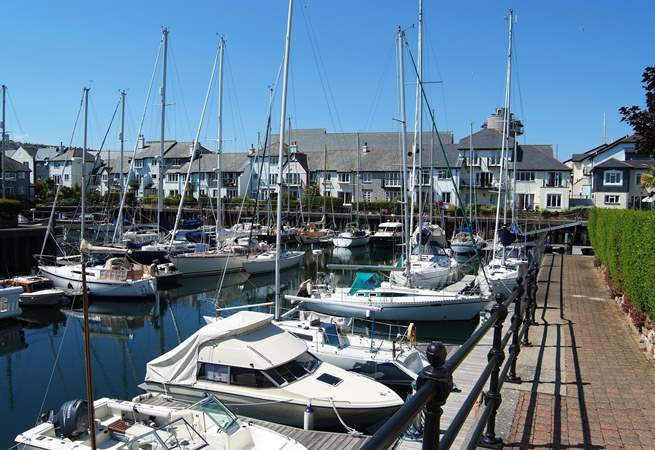 The nearby marina is full of yachts of all sizes.