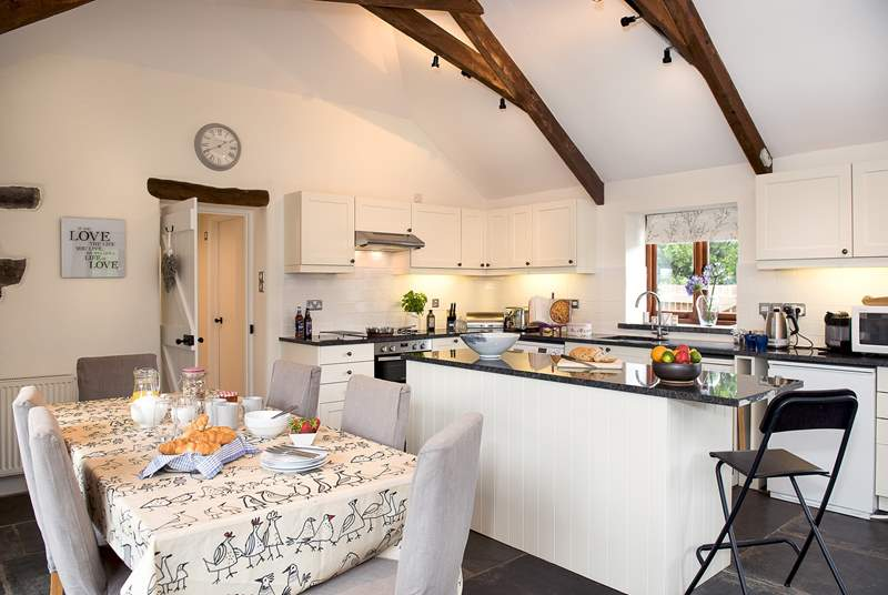 The kitchen/dining-room is a wonderful room which overlooks the patio.