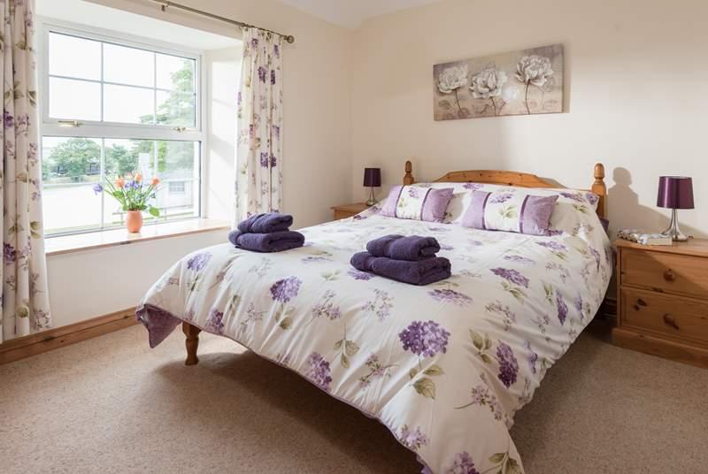 The pretty double bedroom (Bedroom 1) has an en suite shower-room.