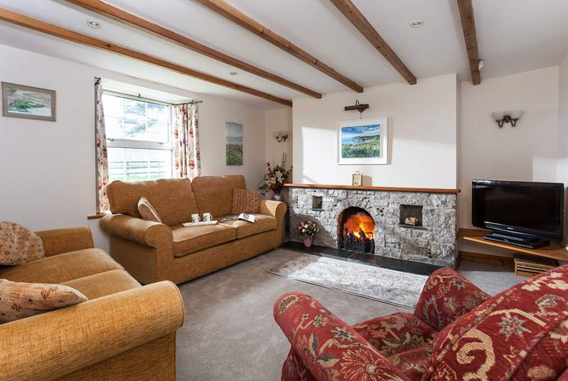 Comfortable sofas and a welcoming open fire in the sitting-area.