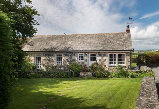 Pretty Corlan Cottage is located in the heart of the village.