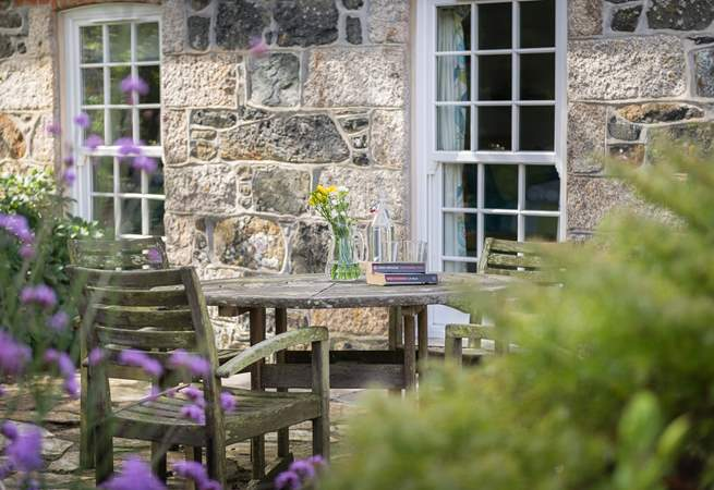 Sit a while at the front of the cottage in this tranquil location.