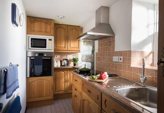 The cottage kitchen may be small but it is surprisingly well-equipped.