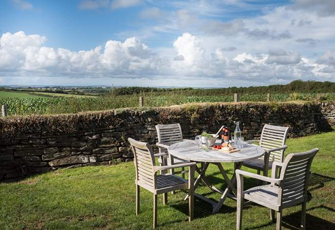 The enclosed, private back garden has wonderful far reaching views across open fields.