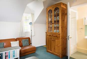 There is a little kitchen-area tucked away beside the dresser on the first floor, and a shower-room too, making this an almost self-contained floor for added independence.