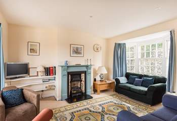 The dual-aspect sitting-room is very light and welcoming.