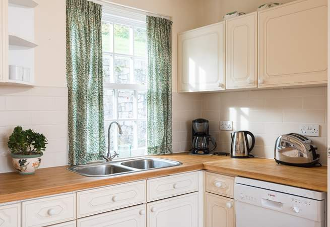 The kitchen-area is light and bright and fully equipped.