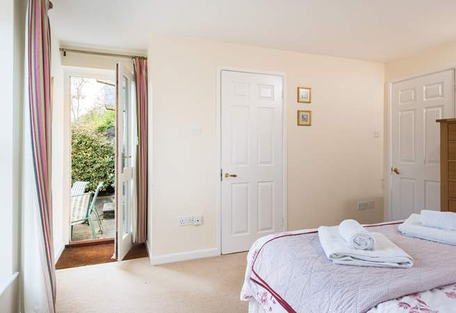 The double bedroom has a door out to the terrace (Bedroom 1).
