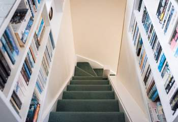 Steep stairs lead down from the first floor (please take care with children).