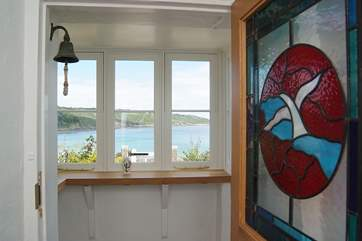The view from the front door through the entrance porch to the sea, just across the road from Carndu.