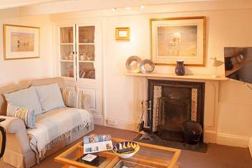 The cosy sitting-room is furnished with two sofas and has an open fire so you can get warm and cosy on those cooler evenings.