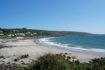 The sandy beach in the lovely bay at Coverack at high tide.