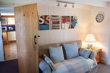 Looking through to the kitchen from the sitting-room, there are lots of lovely touches in this pretty  cottage by the sea.