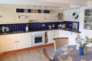 The kitchen is very well-equipped with room to cook and dine, breakfast, lunch and dinner.
