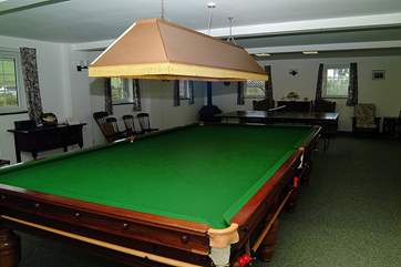 The full-size billiard table can provide hours of enjoyment.