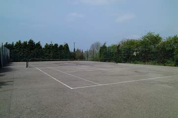 The full-size tennis court which guests are welcome to use.