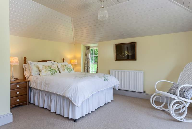 The master bedroom has a super-comfy bed, and is full of light.