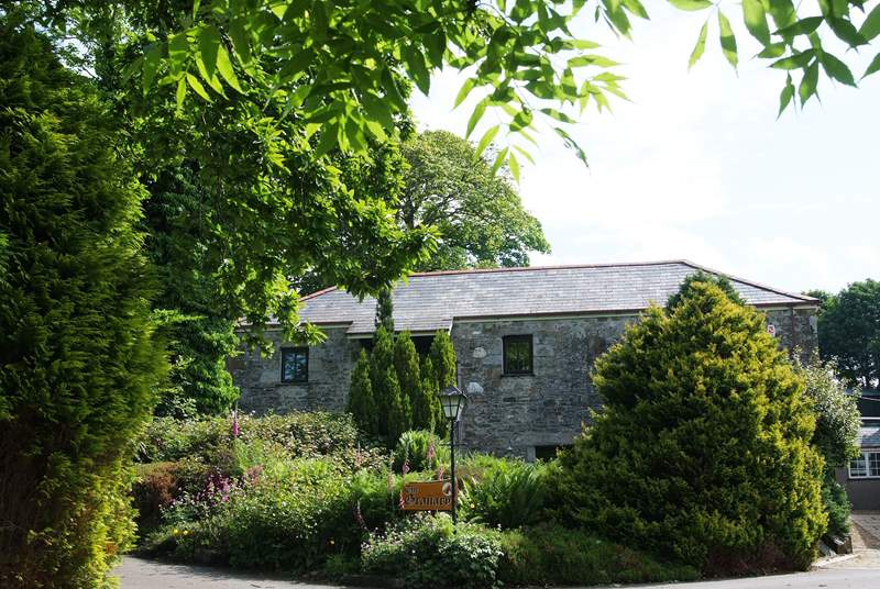 The approach to Polwrath Granary. With the pool-room behind the cottage and the Owners' house to the right.