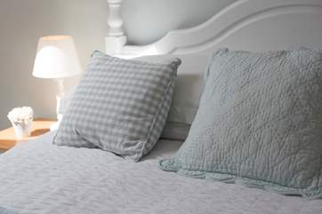 Cushions for comfort as you read in bed.