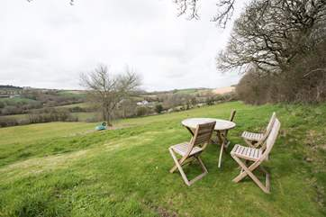 A sitting-area looks out over rolling countryside.