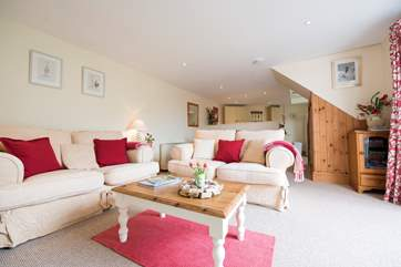 The open plan living-room is wonderfully spacious and cosy.
