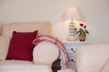 Lovely lamps, throws and cushions add comfort and charm.